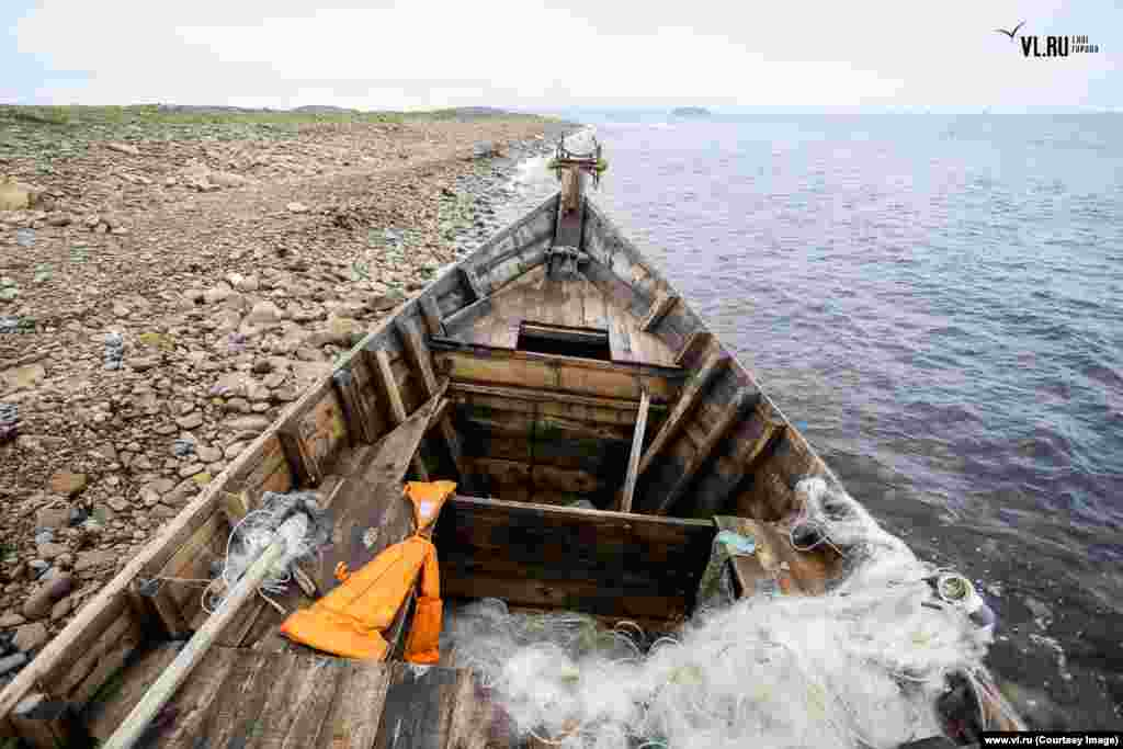 A North Korean fishing vessel discovered on Russky Island by local surfers on August 09. The current wave of stricken vessels washing up on Russian shores may be set to continue.