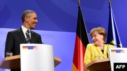 U.S. President Barack Obama (left) and German Chancellor Angela Merkel address a press conference after their bilateral talks at the Herrenhausen Palace in Hannover on April 24.