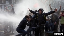 Azerbaijan -- Policemen use water cannons to break up the crowd of protesters during a rally in Baku, 10Mar2013