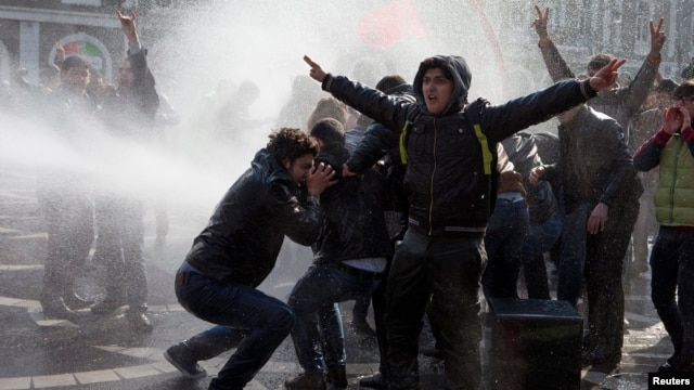 Azerbaijani police use water cannons to break up a crowd of protesters during a rally in Baku in March.
