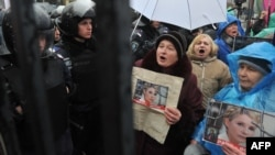 Supporters of Yulia Tymoshenko hold pictures of the opposition leader during a rally in front of a court in Kyiv on December 20.