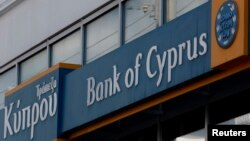 Greece -- Tho logo of the Bank of Cyprus is seen at one of its branches in Athens, 17Mar2013