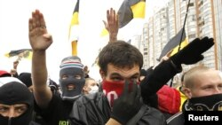 "Ultranationalists gesture during the ""Russian March"" demonstration on National Unity Day in Moscow"