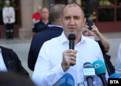 "President Rumen Radev speaks at an anti-government protest in Sofia in July. ""Confidence in the ruling majority has been irretrievably lost,"" he says."