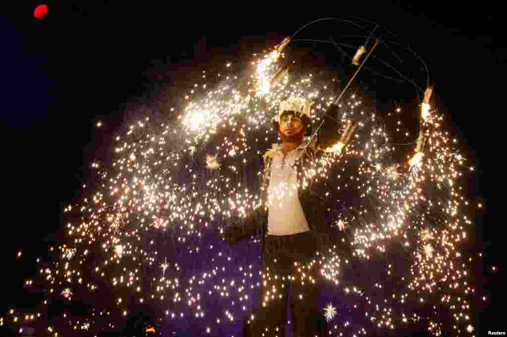 An artist performs during the annual Kyiv Fire Fest in Kyiv. (Reuters/Valentyn Ogirenko)