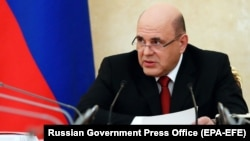 Russian Prime Minister Mikhail Mishustin attends a government meeting in Moscow on March 20.
