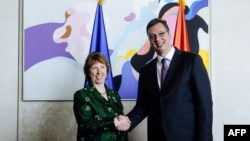 New Serbian Prime Minister Aleksandar Vucic (right) welcomes EU foreign policy chief Catherine Ashton in Belgrade on April 28.