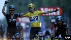 British winner Christopher Froome (center) celebrates with Team Sky teammates after crossing the finish line in Paris of the 100th running of the Tour de France on July 21.