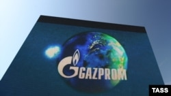 The Gazprom logo rises above the site in Shakai of the first joint of a Minsk-Vilnius-Kaunas-Kaliningrad gas pipeline in 2009.
