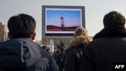 North Koreans in Pyongyang watch a public broadcast of a previous missile launch. (file photo)