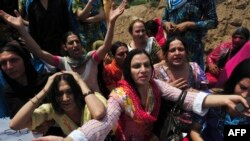 Pakistani eunuchs and transgenders demonstrate for their rights in the city of Peshawar in 2011.