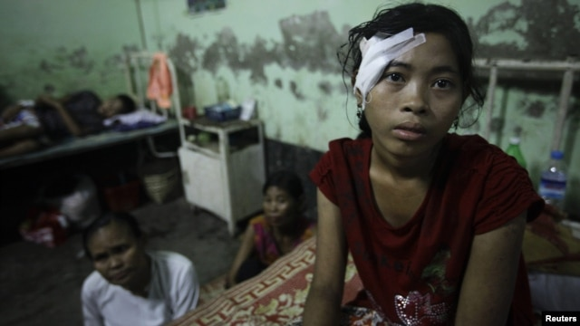 A victim of recent violence in Burma rests in hospital after being treated for a gunshot wound.