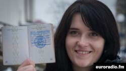 Anastasia Palazhanka brandishes her passport in an undated photo.