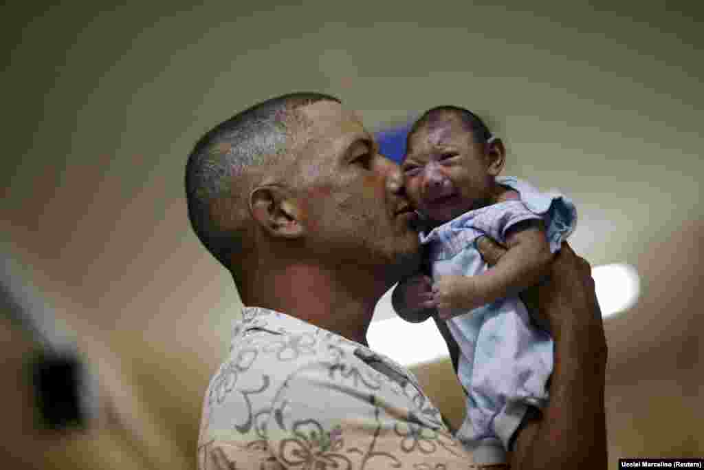 Geovane Silva holds his son Gustavo Henrique, who has microcephaly, at a hospital in Recife, Brazil, on January 26. Health authorities in Brazil reported an alarming surge this year in cases of microcephaly, a developmental problem characterized by small head size. The condition has been linked to the mosquito-borne Zika virus. (Reuters/Ueslei Marcelino)