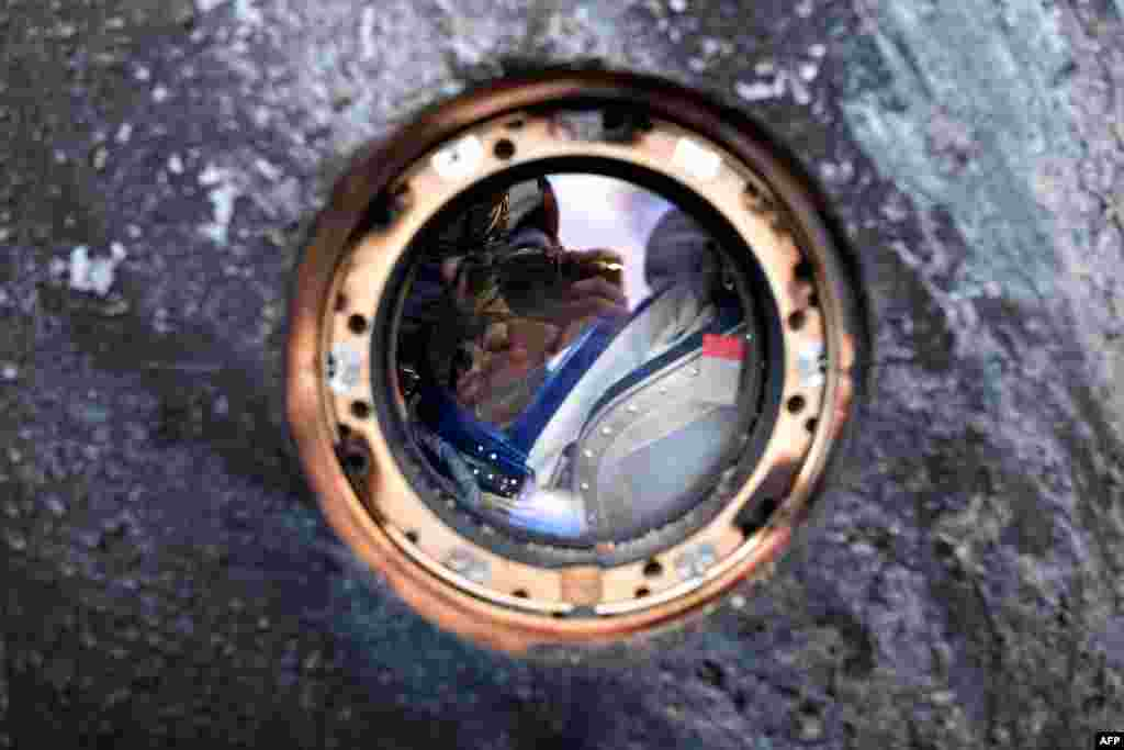 Russian cosmonaut Mikhail Kornienko is seen inside a Soyuz TMA-18M space capsule upon landing near the town of Dzhezkazgan, Kazakhstan, on March 2. Kornienko and U.S. astronaut Scott Kelly had returned from the International Space Station after 340 days. (AFP/Kirill Kudryavtsev)