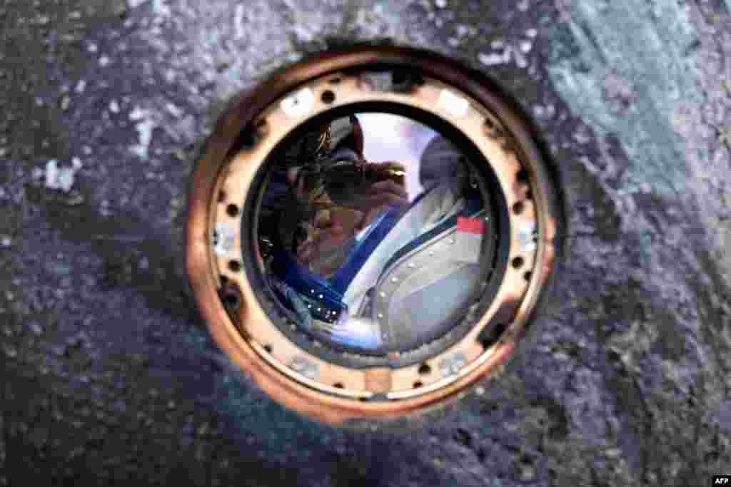 Russian cosmonaut Mikhail Kornienko is seen inside a Soyuz TMA-18M space capsule upon landing near the town of Dzhezkazgan, Kazakhstan, on March 2. Kornienko and U.S. astronaut Scott Kelly had returned from the International Space Station after 340 days. (AFP/Kirill Kudryavtsev)