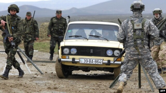 U.S. and Azerbaijani soldiers participate in a joint NATO military exercise outside Baku in April 2009.