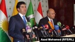 المرشح لرئاسة حكومة إقليم كردستان الجديدة نيجيرفان بارزاني ونائب رئيس الإتحاد الوطني الكردستاني برهم صالح في مؤتمر صحفي في السليمانية