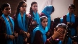 Members of Afghanistan's first all-female orchestra Zohra get ready for a performance in Modra, Slovakia, on July 15.
