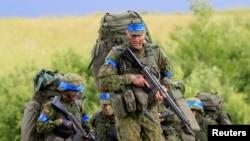 Сувалкский ауданында НАТО әскери жаттығуына қатысып жатқан литвалық сарбаздар. 17 маусым 2017 жыл.