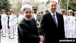 İran prezidenti Hassan Rohani Tehranda Azərbaycan prezidenti İlham Əliyevi salamlayır - 9 aprel 2014