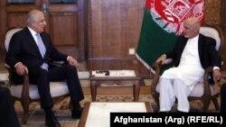 Afghan President Ashraf Ghani (right) meets with U.S. envoy Zalmay Khalilzad in Kabul in July.