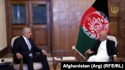 Afghan President Ashraf Ghani (right) meets with U.S. envoy Zalmay Khalilzad in Kabul in July.