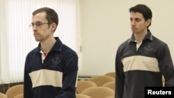 U.S. nationals Shane Bauer (left) and Josh Fattal, detained in Iran on spying charges, during the first session of their trial in a Tehran Revolutionary Court on February 6
