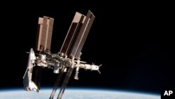 Space -- The International Space Station and the docked space shuttle Endeavour, 23May2011