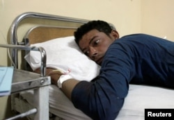 A police cadet who was injured in an attack on the center, lies in a hospital in Quetta, Pakistan on October 25, 2016.