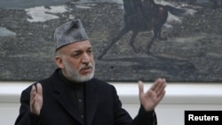 Afghan President Hamid Karzai speaks during a meeting at the presidential palace in Kabul with the family members of civilians allegedly killed by a U.S. soldier in Kandahar last week.