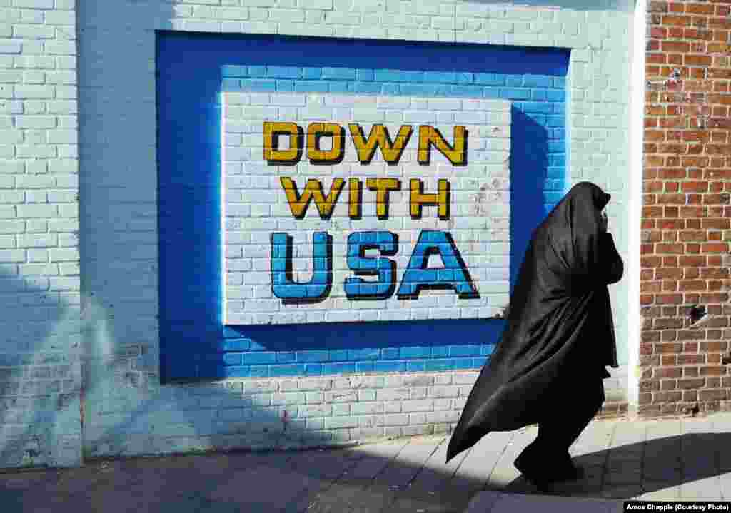 A slogan on the wall of the former U.S. Embassy in Tehran. Murals like this one are at odds with statistics showing that despite ongoing U.S. sanctions, more Iranians feel positively about America than do Turks or Indians.