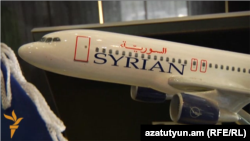 Armenia -- A model of a Syrian Air plane in the airline's office in Yerevan.