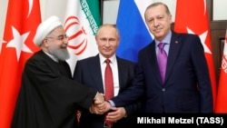 (Right to left:) Turkish President Tayyip Erdogan, Russian President Vladimir Putin and Iranian President Hassan Rohani at a meeting in Sochi in November 2017.