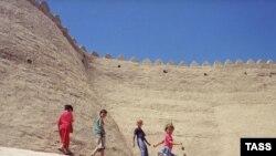 Children play near the ancient walls of the Uzbek city of Khiva.