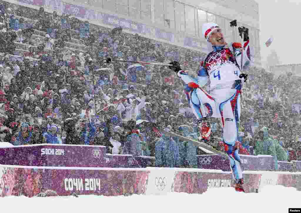 The Czech Republic's Ondrej Moravec celebrates after crossing the finish line for the bronze medal in the men's 15-kilometer mass-start biathlon. (Reuters/Carlos Barria)