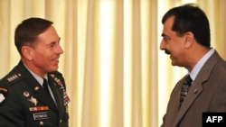 Pakistan's Prime Minister Yousaf Raza Gilani (right) greeting U.S. General David Petraeus in Islamabad.