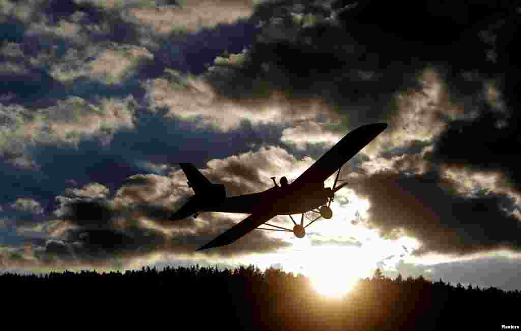 Locksmith Frantisek Hadrava pilots Vampira, an ultralight plane near the village of Zdikov, Czech Republic. Hadrava spent two years building the plane so he could fly to work and cut down on his commuting time. (Reuters/David W. Cerny)