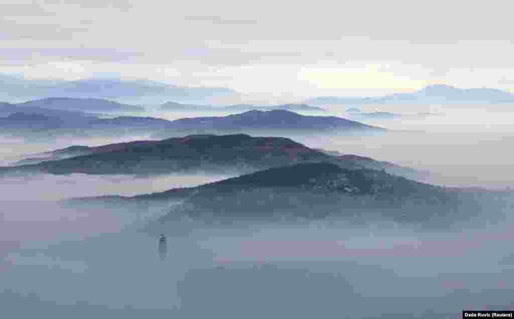 Smog envelopes the city of Sarajevo in Bosnia-Herzegovina on December 3. (Reuters/Dado Ruvic)