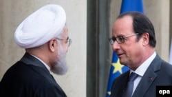 Эрон президенти Ҳасан Руҳоний ва Франция президенти Франсуа Олланд.