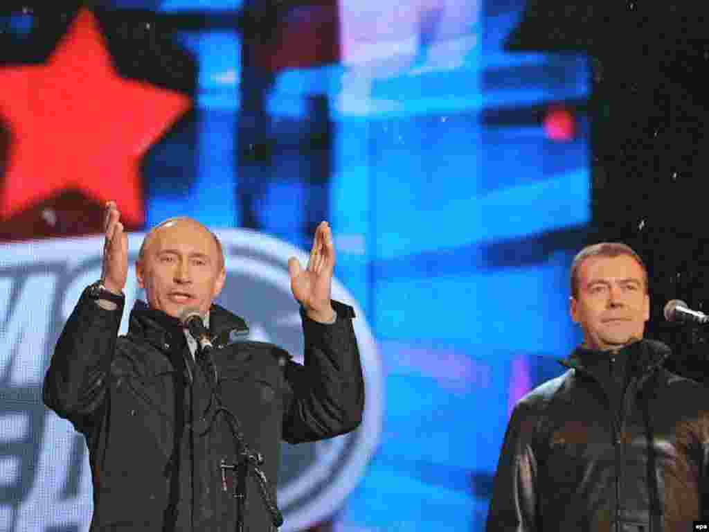 Vladimir Putin and Dmitry Medvedev celebrate the latter's election victory in Red Square - Russian President Vladimir Putin (L) and First Vice Premier and presidential candidate Dmitry Medvedev (R) during the concert on the Red Square 02 March 2008