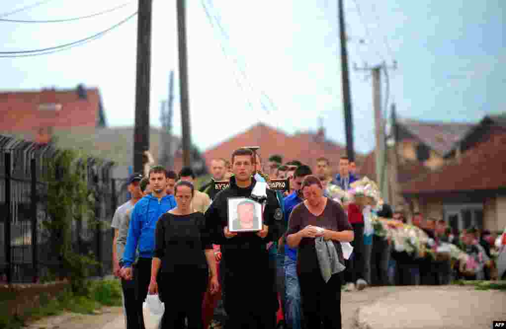 The funeral procession for Zarko Kuzmanovski, one of the slain police officers, in the village of Brvenica near Tetovo