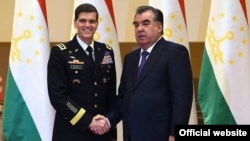 Tajik President Emomali Rahmon (right) meets with U.S. Central Command commander, General Joseph Votel, in Dushanbe on June 15.
