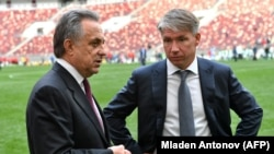 Russian Deputy Prime Minister Vitaly Mutko (left) and Aleksei Sorokin talk after the FIFA World Cup Trophy Tour opening ceremony at Luzhniki Stadium in Moscow in September.