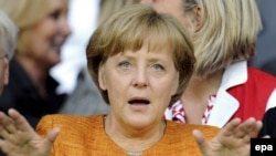 Merkel: eyes wide open