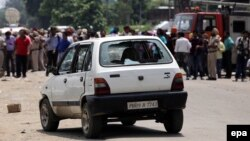 A car used by alleged militants is seen with smashed windows outside the police station in Dinanagar, Gurdaspur on July 27