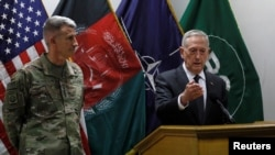 U.S. Defense Secretary James Mattis, right, and U.S. Army General John Nicholson, commander of U.S. Forces Afghanistan, at a news conference in April in Kabul.