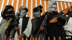 It is hoped that the release of Mullah Abdul Ghani Baradar could help ensure that more Taliban fighters like these men put down their guns. (file photo)