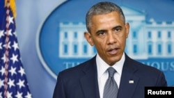 Президент США Барак Обама выступает с заявлением по Украине. Вашингтон, 18 июля 2014 года.