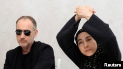 Anzor Tsarnaev (left) and Zubeidat Tsarnaeva, parents of Tamerlan and Dzhokhar Tsarnaev, at a news conference in Makhachkala on April 25